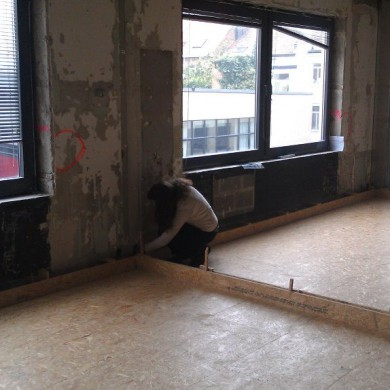 Sept 12, 2011 - Silvia checking the floating floor just before the screed is poured on it @ TBWA\ Studios in Brussels. Studios are on the 2nd floor, so while the building is well built, we have to be careful with the load capacity. The floors could not be too heavy, but we managed to have their natural frequency just near 8Hz, so will get the job done just right — with Silvia Santafé.