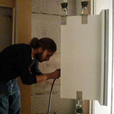 Oct 30, 2011 - Thomas Jouanjean installing & checking the decoupled nacelles before the space between the two windows can be finished @ TBWA Brussels Studio A & B.